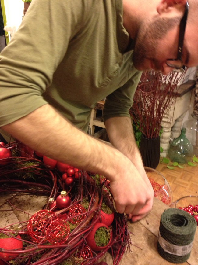Me making a handmade Red Dogwood wreath.