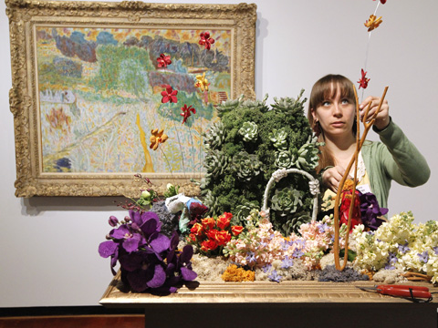 STANDALONE PHOTO -- Laura Daluga creates a floral display to compliment a 1945 painting by Pierre Bonnard while setting up for Art In Bloom Thursday, March 27, 2014 at the Milwaukee Art Museum in Milwaukee, Wis. Floral designs will be on display through Sunday. The designers use flowers and foliage to interpret works from the museum's collection. In addition to the colorful displays, there will be demonstrations and classes in everything from vertical gardening to making sugar flowers. Daluga is from Chicago. Mark Hoffman/MHOFFMAN@JOURNALSENTINEL.COM